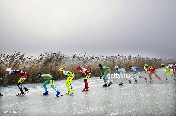 Competitors of the Dutch Ice Skating Championship Marathon are seen on the Oostvaardersplassen nature reserve, in Lelystad on January 8, 2009. The...
