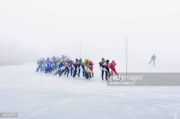 Competitors of the women's Dutch Ice Skating Championship Marathon are seen on the Oostvaardersplassen nature reserve, in Lelystad on January 8,...