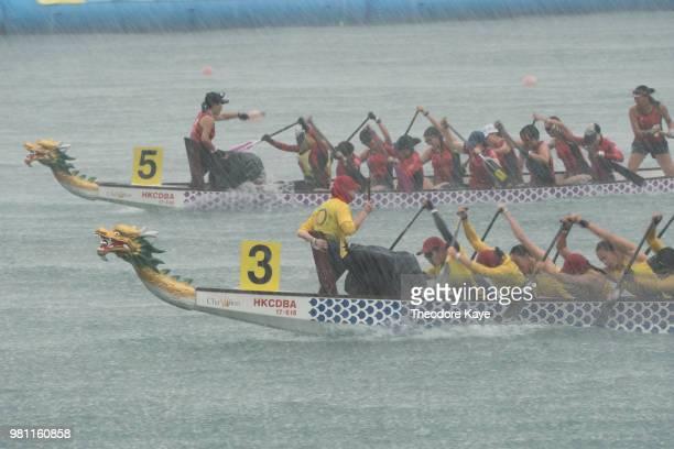 Competitors paddle their boats during a race at the Hong Kong Dragon Boat Carnival on June 22 2018 in Hong Kong Hong Kong