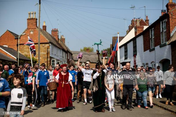 Competitors parade through the town ahead of the traditional Easter Monday 'Bottle Kicking' match on April 22 2019 in Hallaton England The Bottle...