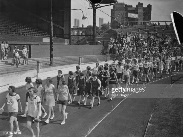 Competitors parading at Stamford Bridge during the Fourth Annual Athletic Meeting of the Laundry Industry Sports Club London UK 20th August 1932