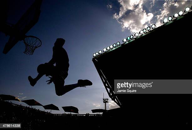 Competitors participate in a slam dunk contest prior to the 3x3 Basketball Finals during day fourteen of the Baku 2015 European Games at the...