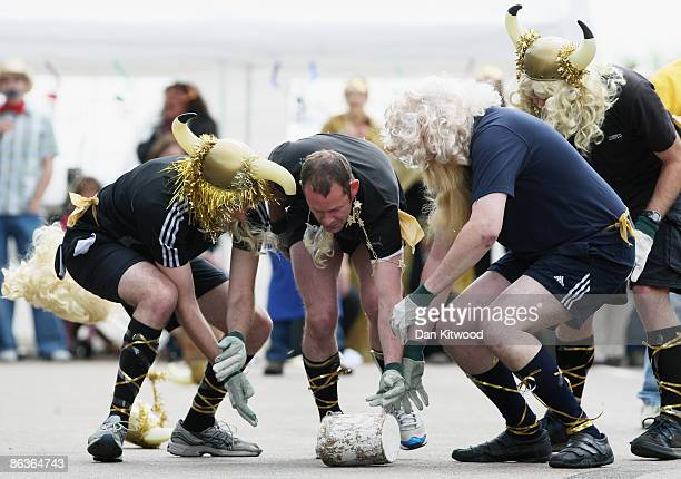 Competitors participate in the Stilton Cheese rolling competition on Stilton High Street on May 4 2009 in Stilton England Cheese Rolling has become...