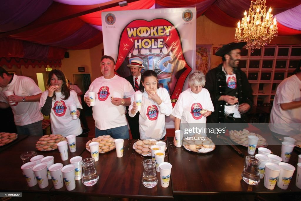 Competitors participate in the Wookey Hole Big Eat, Mince Pie Eating Contest at the Wookey Hole Show Caves on November 29 2006 in Wookey Hole, near Wells, England. 12 handpicked competitors, professionals and members of the public alike, will attempt to eat as many mince pies as possible in the space of 10 minutes.
