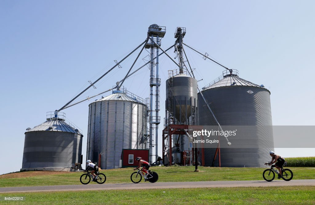 Competitors pass a farm while cycling during the Ironman Madison on September 10, 2017 in Madison, Wisconsin.