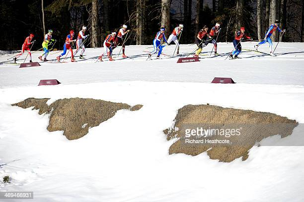 Competitors pass a section of melted snow during the Women's 4 x 5 km Relay during day eight of the Sochi 2014 Winter Olympics at Laura Crosscountry...
