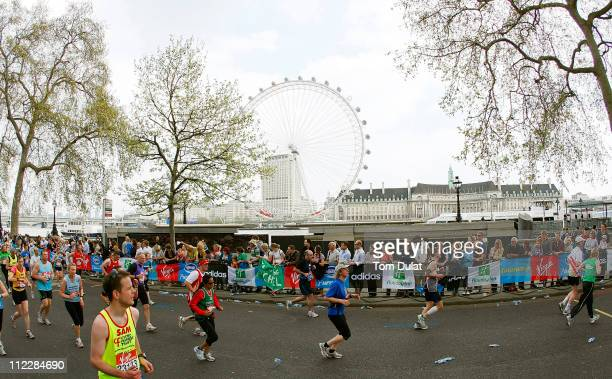 Competitors pass London Eye in the Virgin London Marathon on April 17 2011 in London England 36500 competitors will tackle the 262 mile course which...