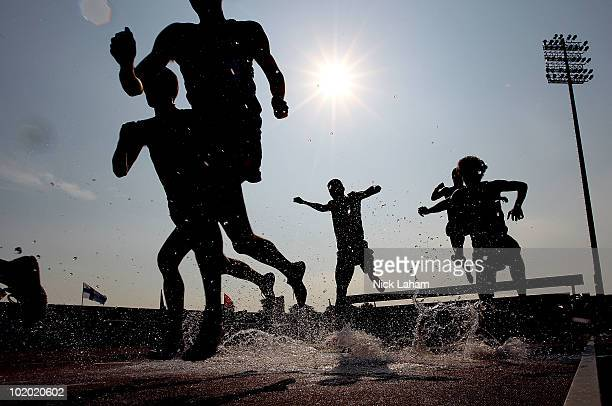 Competitors pass through the water jump in the Men's 3000m Steeplechase during the IAAF Diamond League at Icahn Stadium on June 12 2010 in New York...