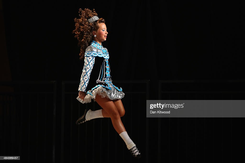 Competitors perform at the World Irish Dance Championship on April 13, 2014 in London, England. The 44th World Irish Dance Championship is currently running at London's Hilton London Metropole hotel, and will host approximately 5,000 dancers competing in solo, Ceili, modern figure choreography and dance drama categories during the week long event.