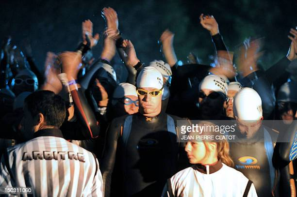 Competitors perform during the 27th edition of the Embrunman triathlon on August 15 2010 in Embrun southeastern France The Embrunman is considered as...