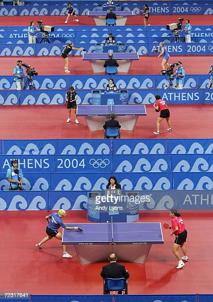 Competitors play during the women's singles table tennis matchs on August 14, 2004 during the Athens 2004 Summer Olympic Games at Galatsi Olympic...