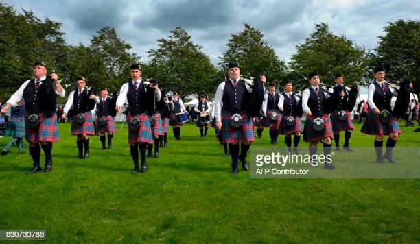 Competitors play the bagpipes as they compete on Glasgow Green as part of the World Pipe Band Championships in Glasgow in Glasgow on August 12 2017...