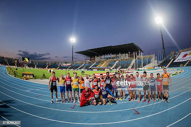 Competitors pose for a photo after finishing the menÕs 1500 metres decathlon during the IAAF World U20 Championships at the Zawisza Stadium on July...