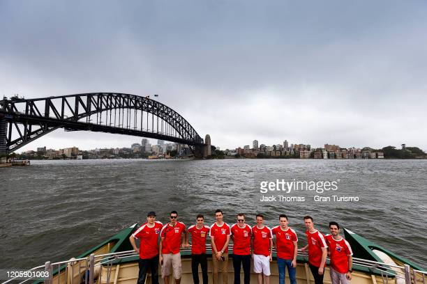 Competitors pose for a photo as they ride the ferry prior to Round 1 of the Gran Turismo World Tour 2020 at Luna Park on February 13 2020 in Sydney...