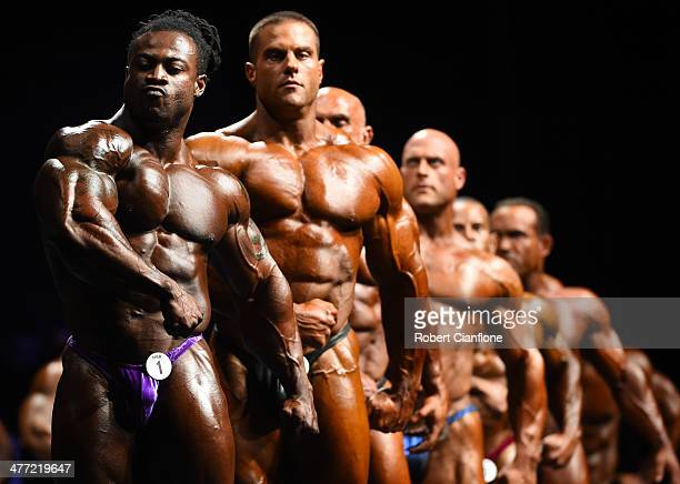 Competitors pose on stage during the IFBB Australian Pro Grand Prix XIV at Plenary Hall on March 8 2014 in Melbourne Australia