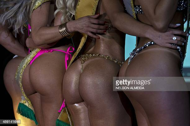Competitors pose on the catwalk during the Miss Bumbum Brazil 2014 pageant in Sao Paulo on November 17 2014 Fifteen candidates compete in the annual...