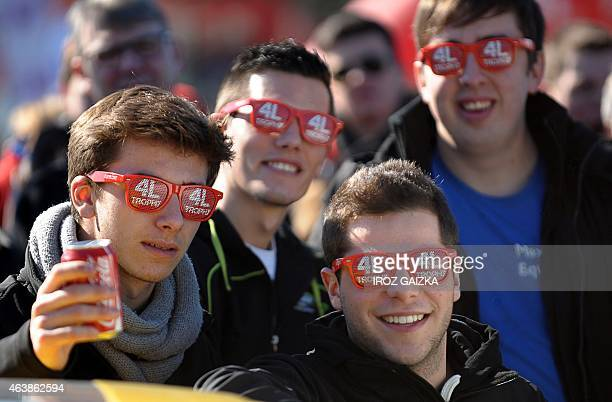 Competitors pose wearing glasses with the logo of the 4L Trophy in Biarritz southwestern France on February 19 prior to the start of the 18th edition...