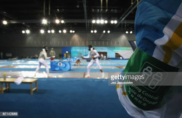 Competitors practice for the fencing under the watchful eye of doping control ahead of the Beijing 2008 Olympic Games on August 1 2008 in Beijing...