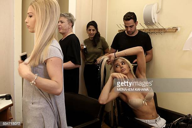 Competitors prepare for Israel's first Miss Trans beauty pageant at Habima national theater in Tel Aviv on May 27 which marks the beginning of the...