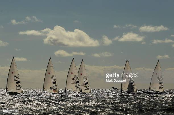Competitors prepare for the Laser Men's One Person Dinghy Medal race on the Centre Course during day 16 of the ISAF Sailing World Championships on...