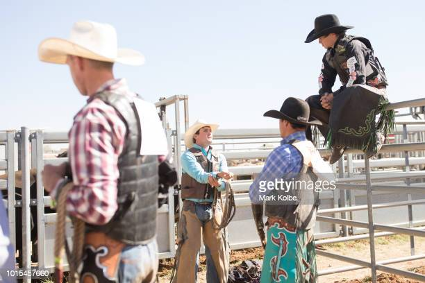 Competitors prepare in the yards behind the chutes for their bull riding event at the 2018 Mount Isa Rotary Rodeo at the Buchanan Park Events Complex...
