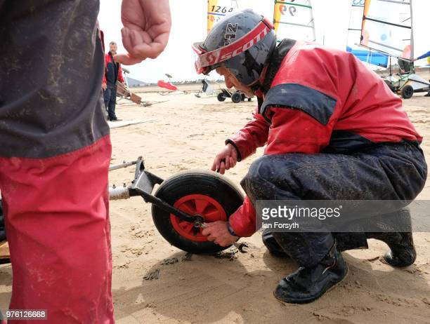 Competitors prepare their equipment during the National Land Sailing regatta held on Coatham Sands on June 16, 2018 in Redcar, England. Land sailing...