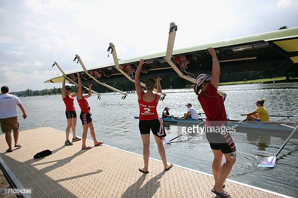 Competitors prepare to take to the water at the end of the first day of the Henley Women's Regatta on June 21 2013 in HenleyonThames England The...