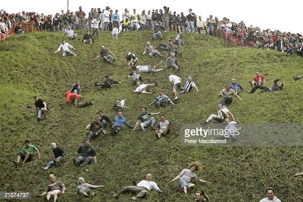 Competitors race down Coopers Hill during a round of Cheese Rolling on May 29 2006 in Gloucester England The annual tradition which is thought to...