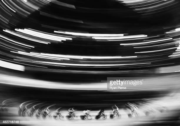 Competitors race during the Men's 40km Points Race Qualifying at Sir Chris Hoy Velodrome during day three of the Glasgow 2014 Commonwealth Games on...
