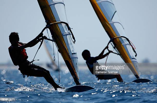 Competitors race during the Mistral OD class windsurfing on day four of the Asian Beach Games at Serangan Island on October 21 2008 in Bali Indonesia