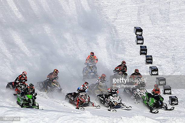 Competitors race for the hole shot in the first round of Snowmobile Snocross at Winter X Games Aspen 2013 at Buttermilk Mountain on January 27 2013...