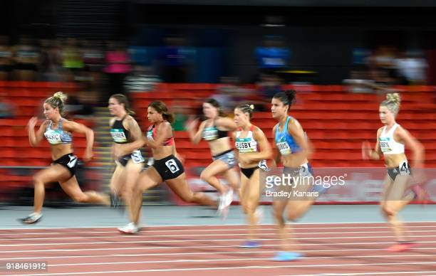 Competitors race in round one of the Women's 100m event during the Australian Athletics Championships Nomination Trials at Carrara Stadium on...