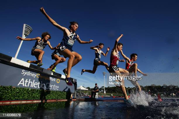 Competitors race in the U20 Mens Steeplechase during the Australian Track and Field Championships at Sydney Olympic Park Athletic Centre on April 03...