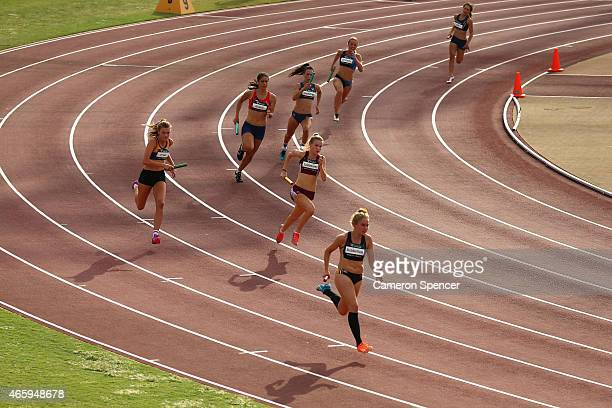 Competitors race in the womens U18 4x100 relay during the Australian Junior Athletics Championships at Sydney Olympic Park on March 12 2015 in Sydney...