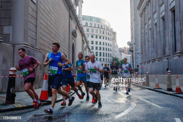 Competitors race past the Bank of England during the Standard Chartered City Race in the City of London, U.K., on Tuesday, July 20, 2021. There's one...