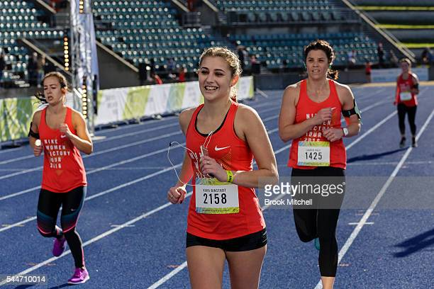 Competitors race to the finish of the Nike Women's Half Marathon at Sydney Olympic Park on July 3 2016 in Sydney Australia