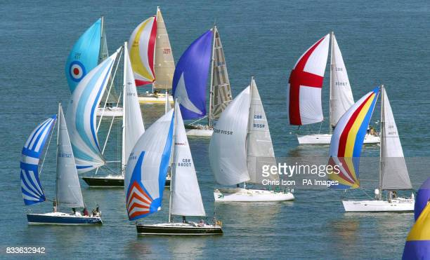 Competitors racing in the 75th Round The Island Race fly their spinnakers including one with a St George's Cross as pass through the Hurst Narrows in...