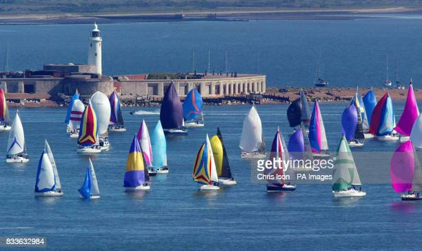 Competitors racing in the 75th Round The Island Race pass through the Hurst Narrows in the western Solent