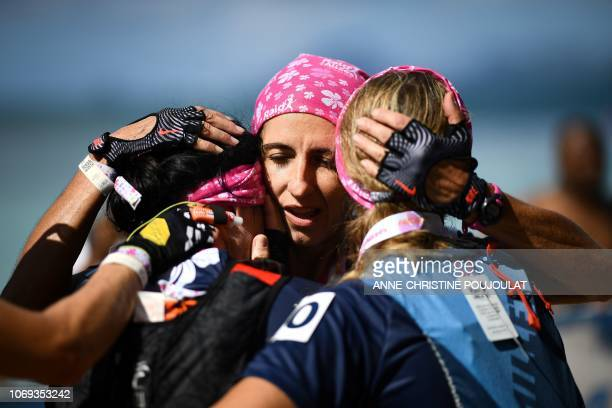 TOPSHOT Competitors react after crossing the finish line during the Raid des Alizes an exclusively allfemale multi sport competition on the French...