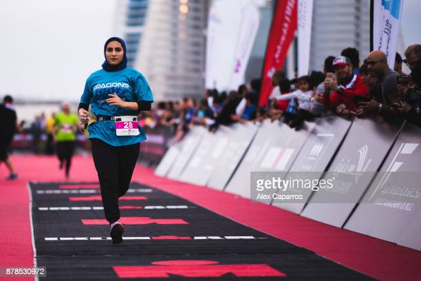 Competitors react as they finish IronGirl race ahead of IRONMAN 703 Middle East Championship Bahrain on November 24 2017 in Bahrain Bahrain