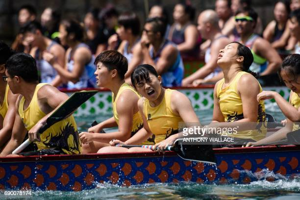 TOPSHOT Competitors react as they take part in the annual dragon boat race held to celebrate the Tuen Ng festival in Hong Kong on May 30 2017 / AFP...