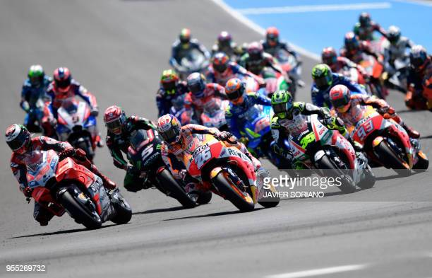 Competitors ride during the start of the MotoGP race of the Spanish Grand Prix at the Jerez Angel Nieto racetrack in Jerez de la Frontera on May 6...