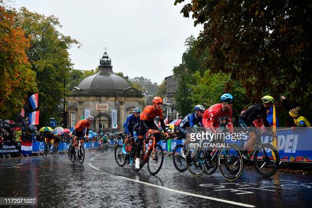 Competitors ride past the Royal Pump Room in Harrogate, northern England, on September 29, 2019 as they compete in the Men's Elite Road Race at the...