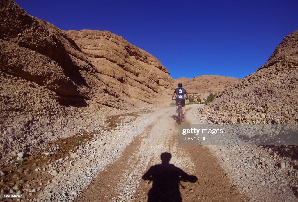 TOPSHOT - Competitors ride their bicycles during stage two of the 13rd  edition of Titan Desert