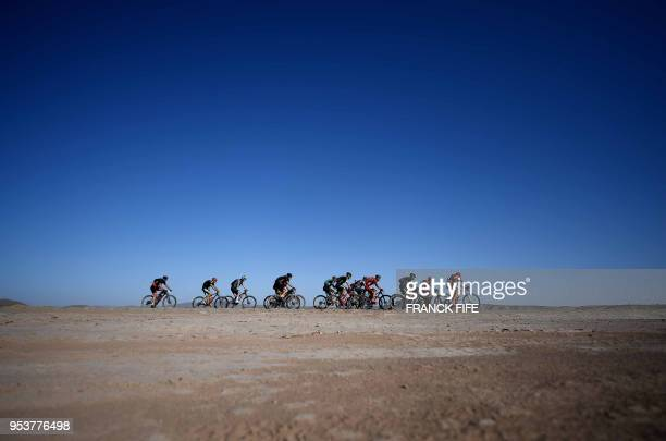 TOPSHOT Competitors ride their bikes during Stage 4 of the 13th edition of the Titan Desert 2018 mountain biking race between Boumalne Dades and...