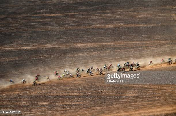 Competitors ride their bikes during Stage 4 of the 14th edition of Titan Desert 2019 mountain biking race between Merzouga and Mssici in Morocco on...
