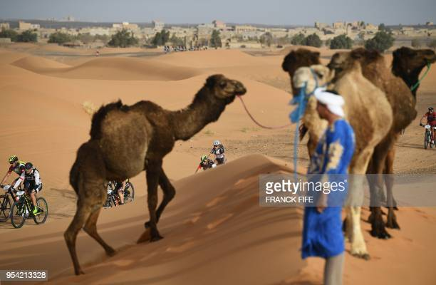 TOPSHOT Competitors ride their bikes during Stage 5 of the 13th edition of Titan Desert 2018 mountain biking race around Merzouga in Morocco on May 3...