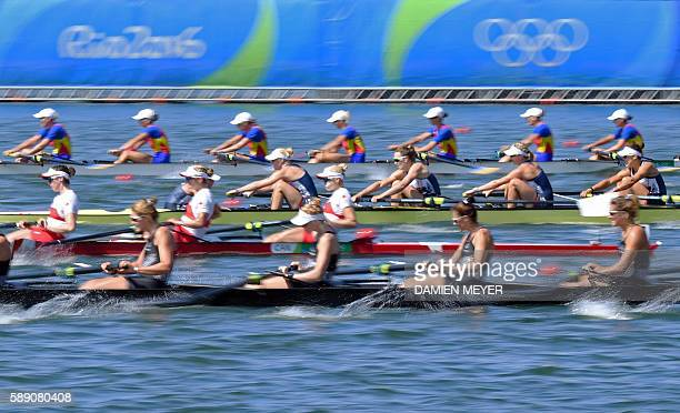 Competitors row during the Women's Eight final rowing competition at the Lagoa stadium during the Rio 2016 Olympic Games in Rio de Janeiro on August...