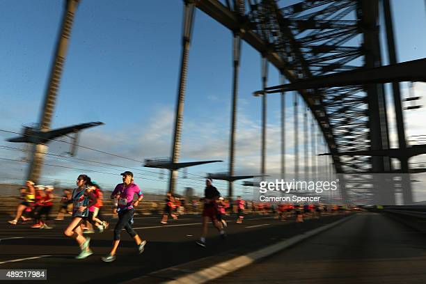 Competitors run across the Sydney Harbour Bridge in the Sydney half-marathon during the Blackmores Sydney Running Festival on September 20, 2015 in...