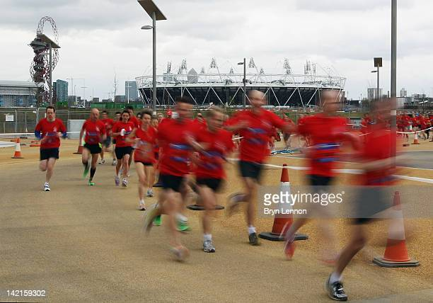 Competitors run around Olympic Park during the National Lottery Olympic Park Run at Olympic Stadium on March 31, 2012 in London, England.
